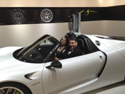 Customer service manager, Doug VanDeven, trying out the Porsche 918 spider ($960,000)